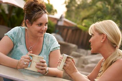 Two Girlfriends Enjoy A Casual Conversation