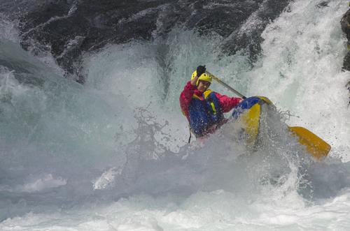 Kayak flipping in rapids.